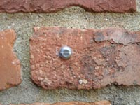 pin set in brickwork